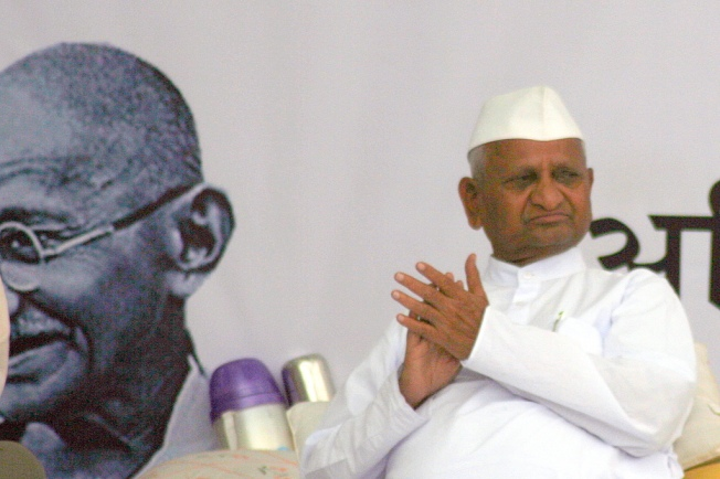 Anna Hazare with Gandhi in the bakdrop